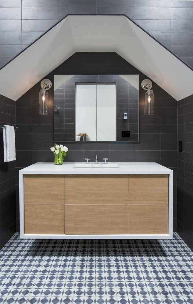 Bathroom With Black Subway Tile And White Vanity