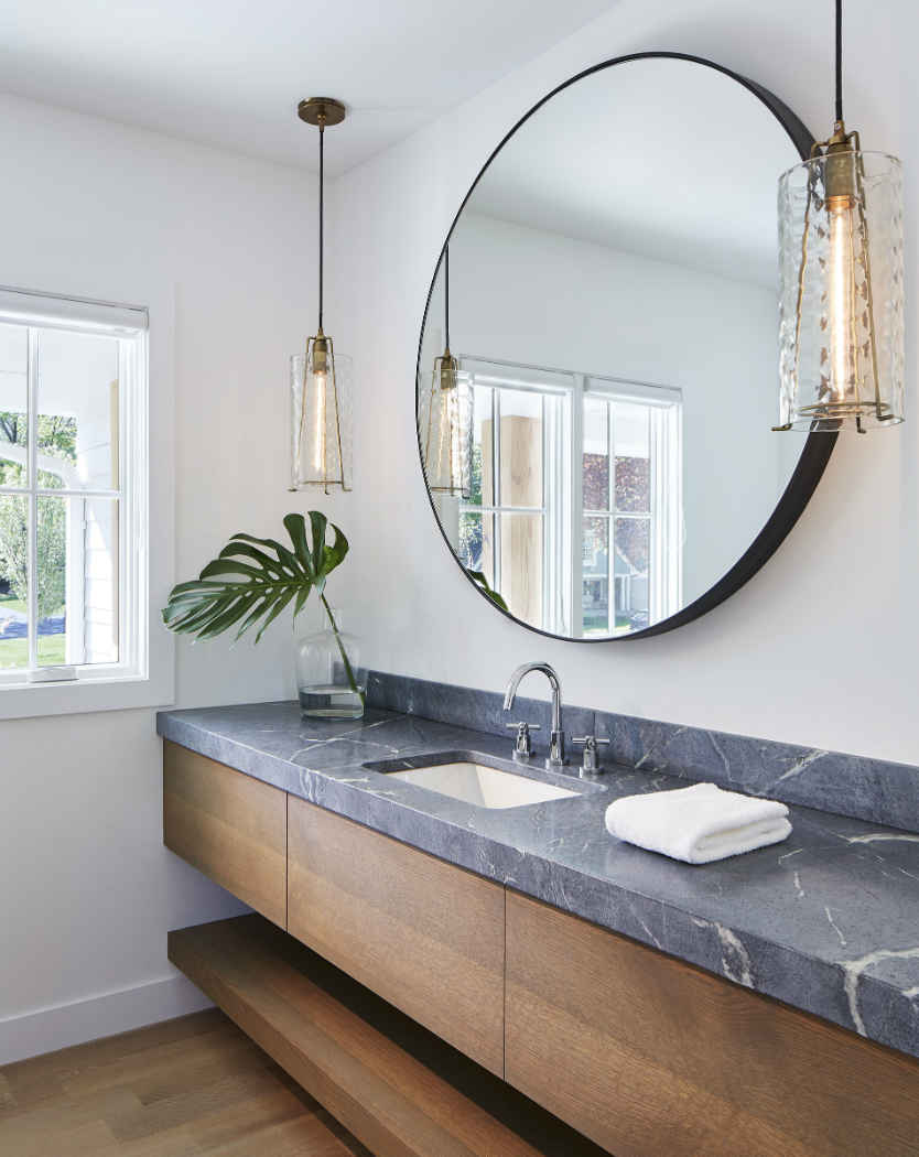 Bathroom With Large Vanity And Circular Mirror