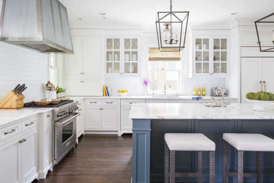 Beautiful White Kitchen With Blue Island