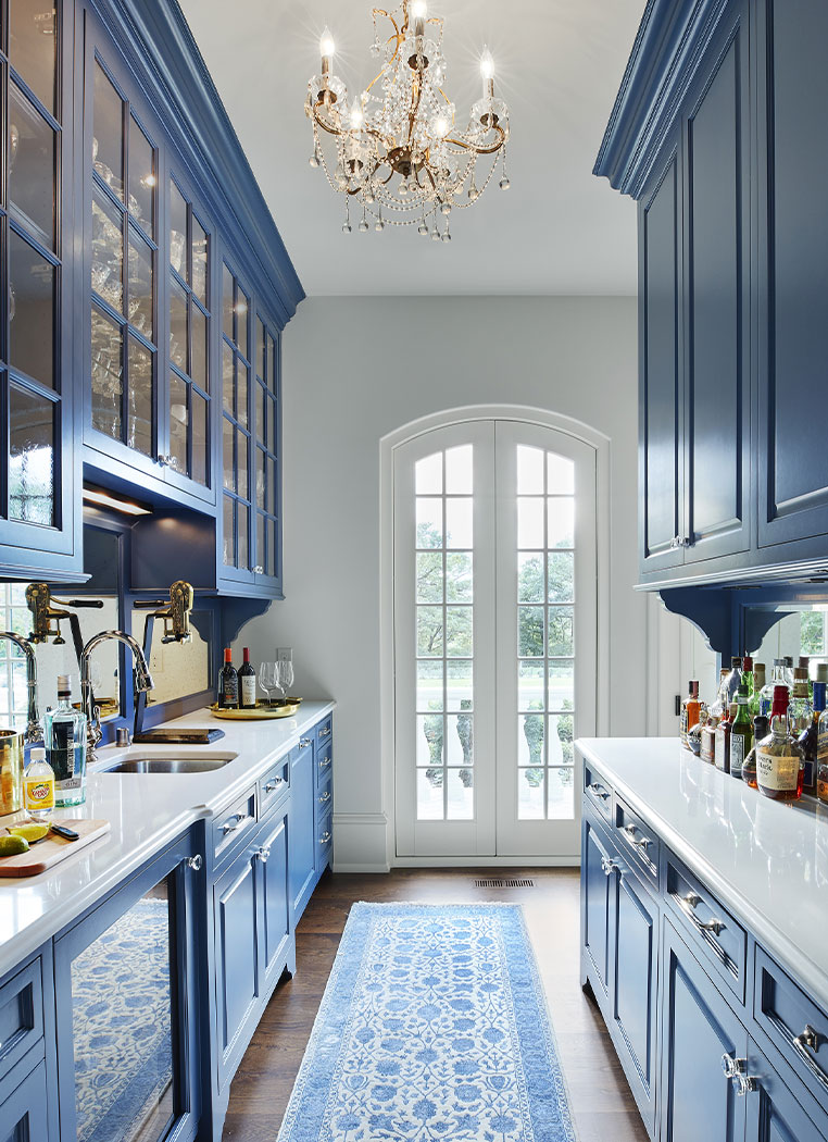 Blue Kitchen Galley With White Countertops
