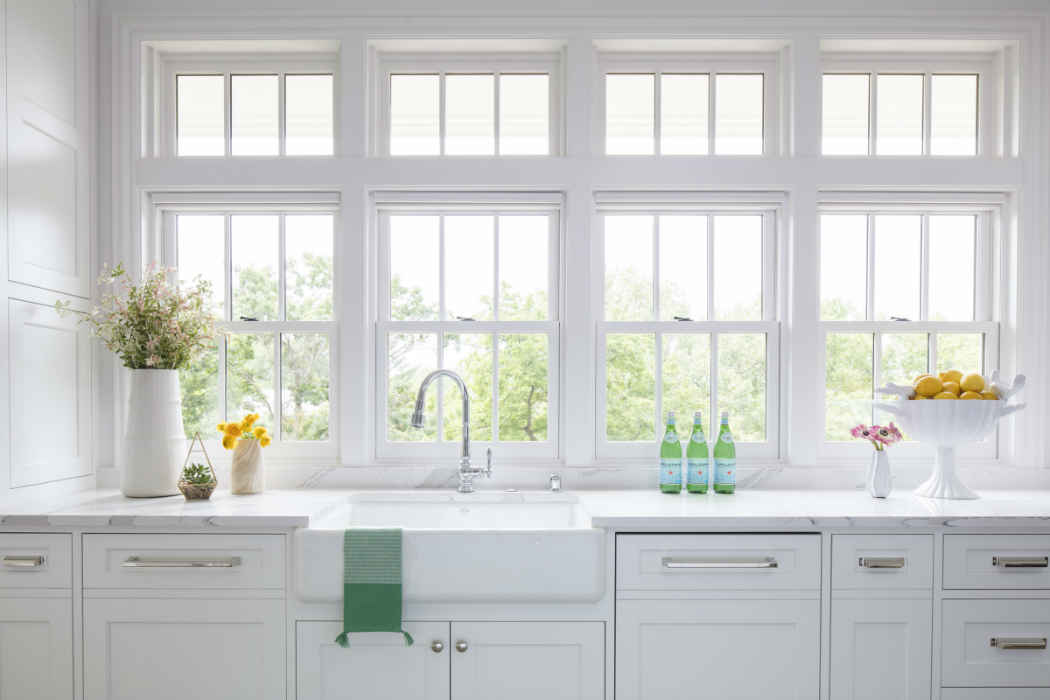Bright White Kitchen With Farmhouse Sink