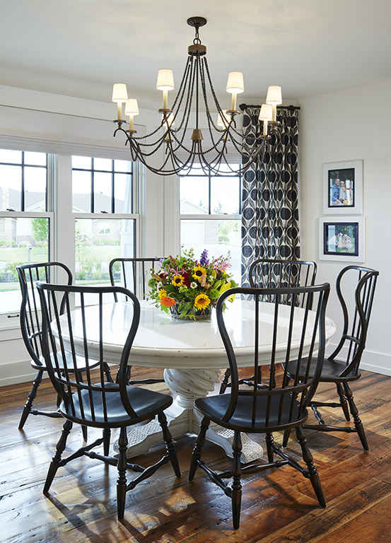 Casual White Dining Table With Black Chairs