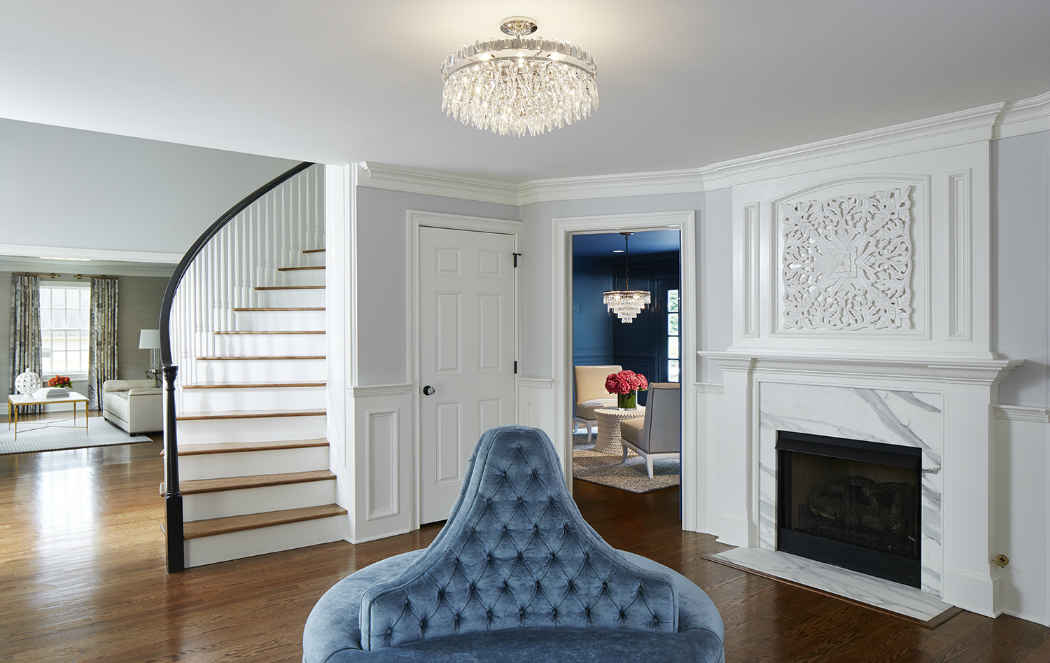 Entry Interior Design With White Marble Fireplace
