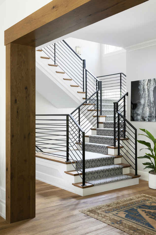 Entryway With Metal Railing Staircase Design