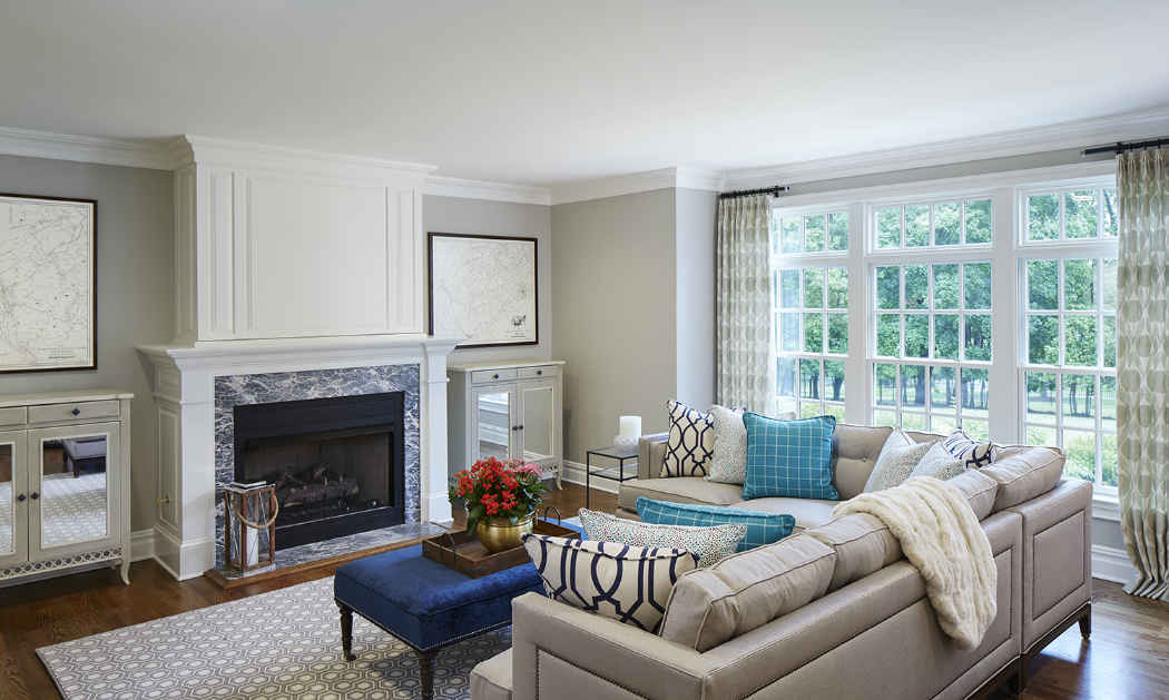Family Living Room Design With Royal Blue Ottoman
