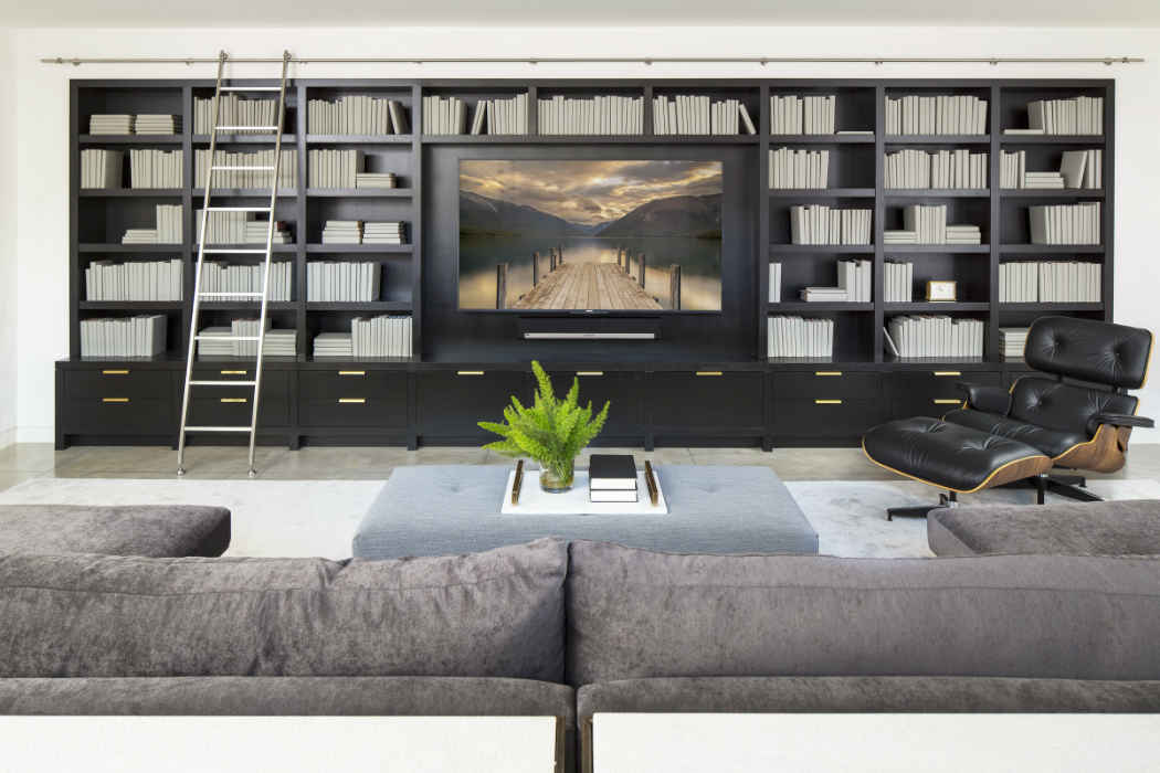 Family Room With Large Black Built In Bookcase