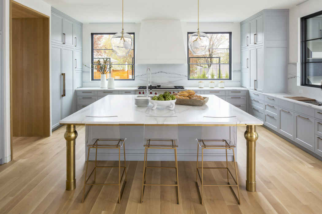Grand White Kitchen Island With Gold Accents