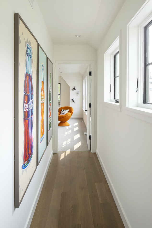 Hallway Design With Colorful Artwork Accents