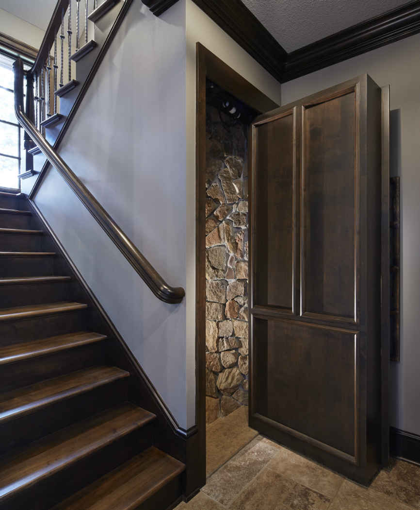 Hidden Doorway Design With Stone Hallway