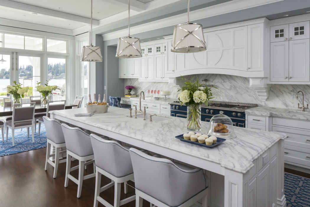 Kitchen With Large Island And Soft Gray Bar Stools