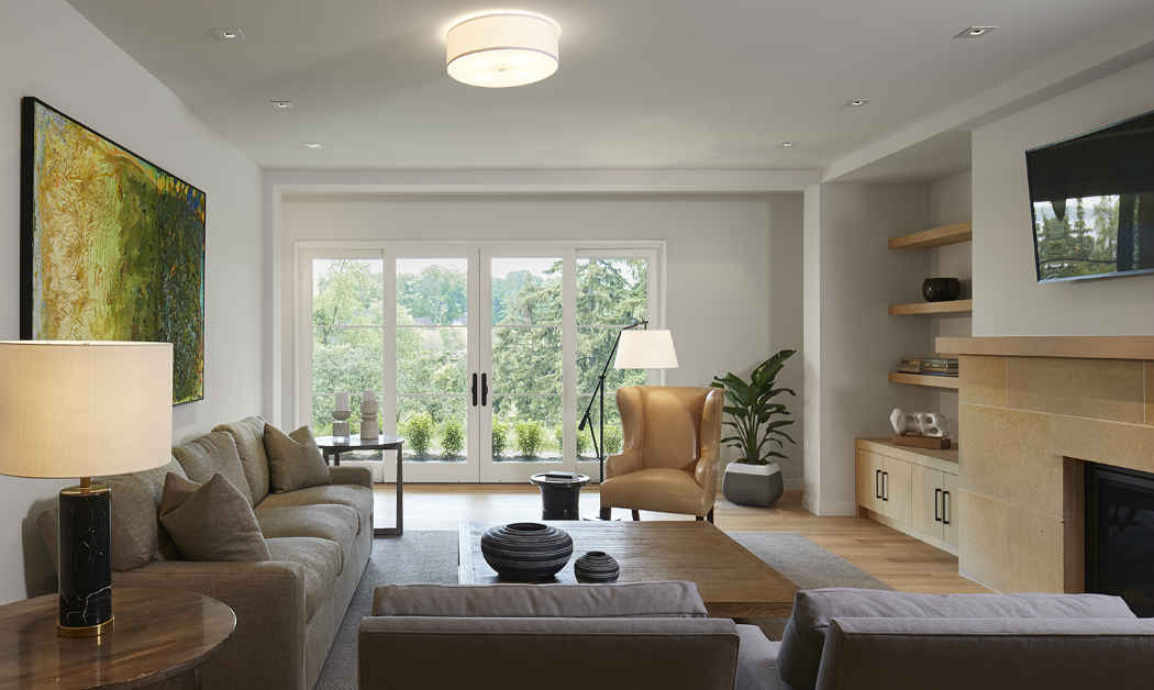Living Room With Large Windows And Natural Tones