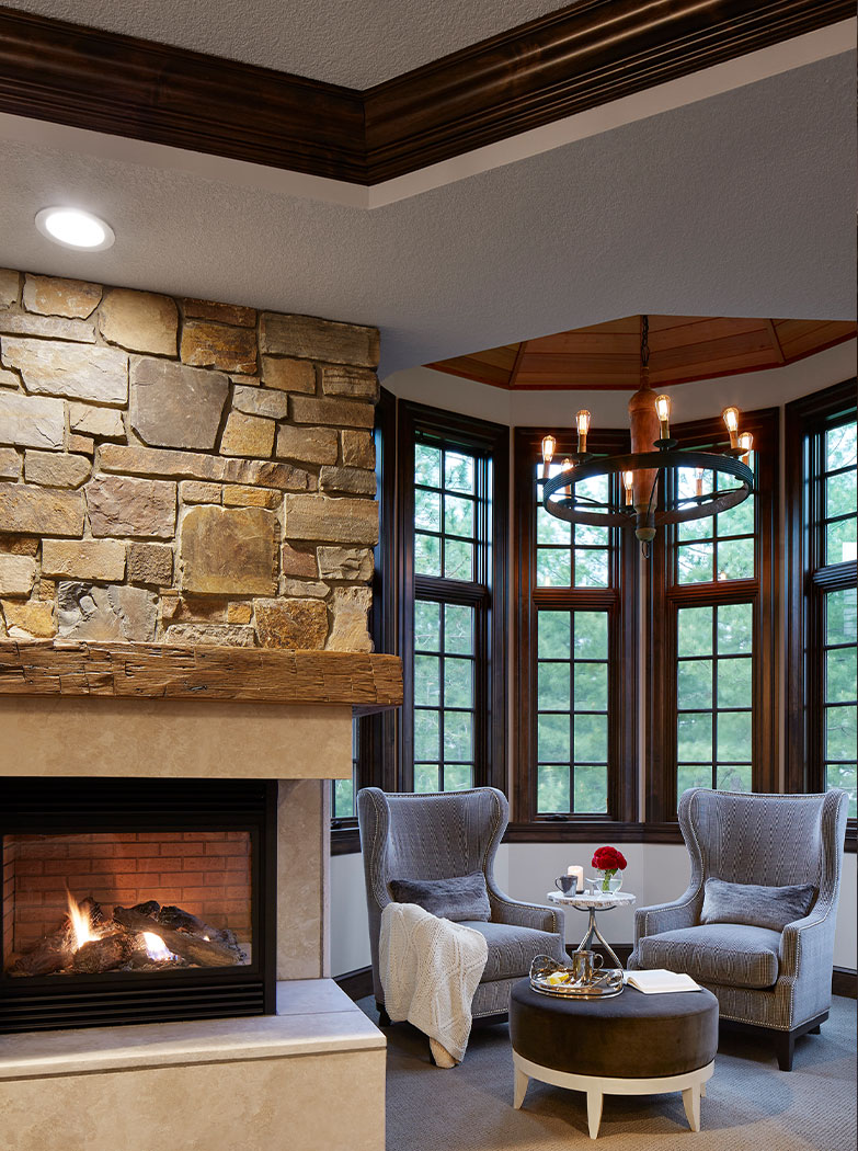 Master Bedroom Sitting Area With Stone Fireplace