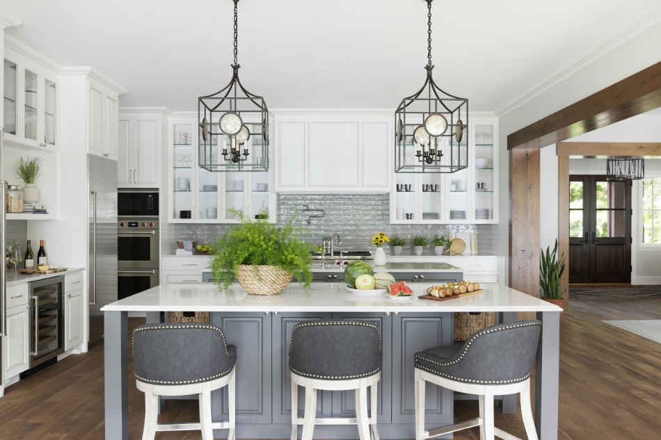 White Kitchen With Deep Gray Island And Studded Bar Stools