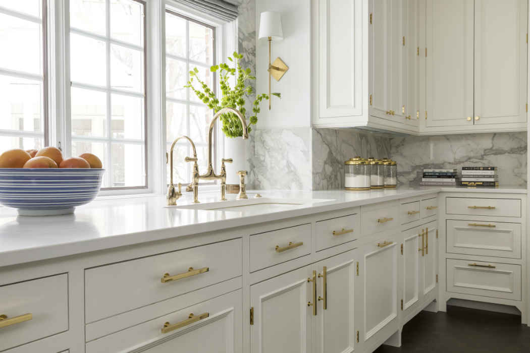 White Kitchen With Gold Finishes