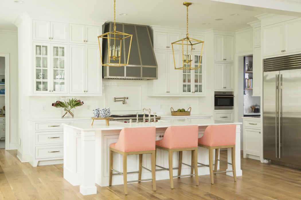 White Kitchen With Salmon Color Bar Stools