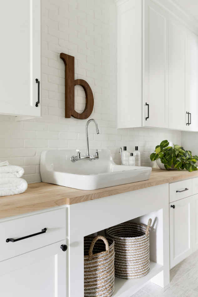 White Laundry With Brick Accent Wall Interior Design