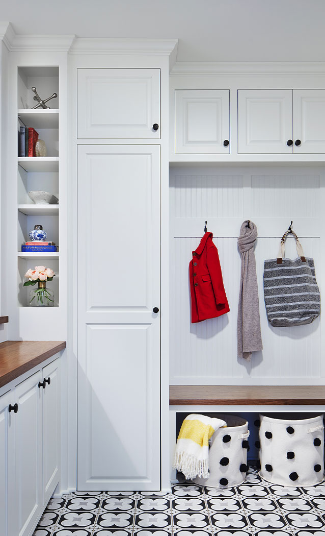 White Mudroom With Accent Tile