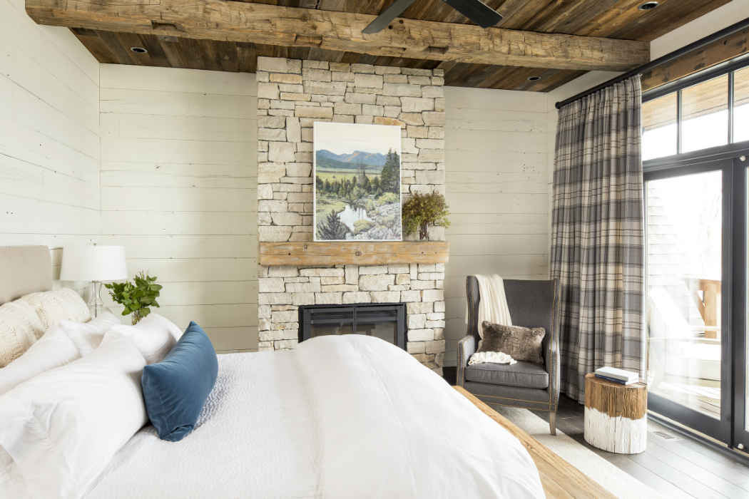 White Shiplap Bedroom With Stone Fireplace