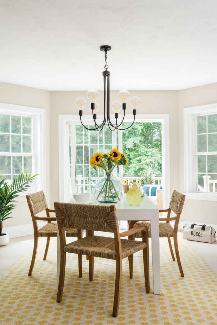 Beautiful White Dinette With Yellow Area Rug