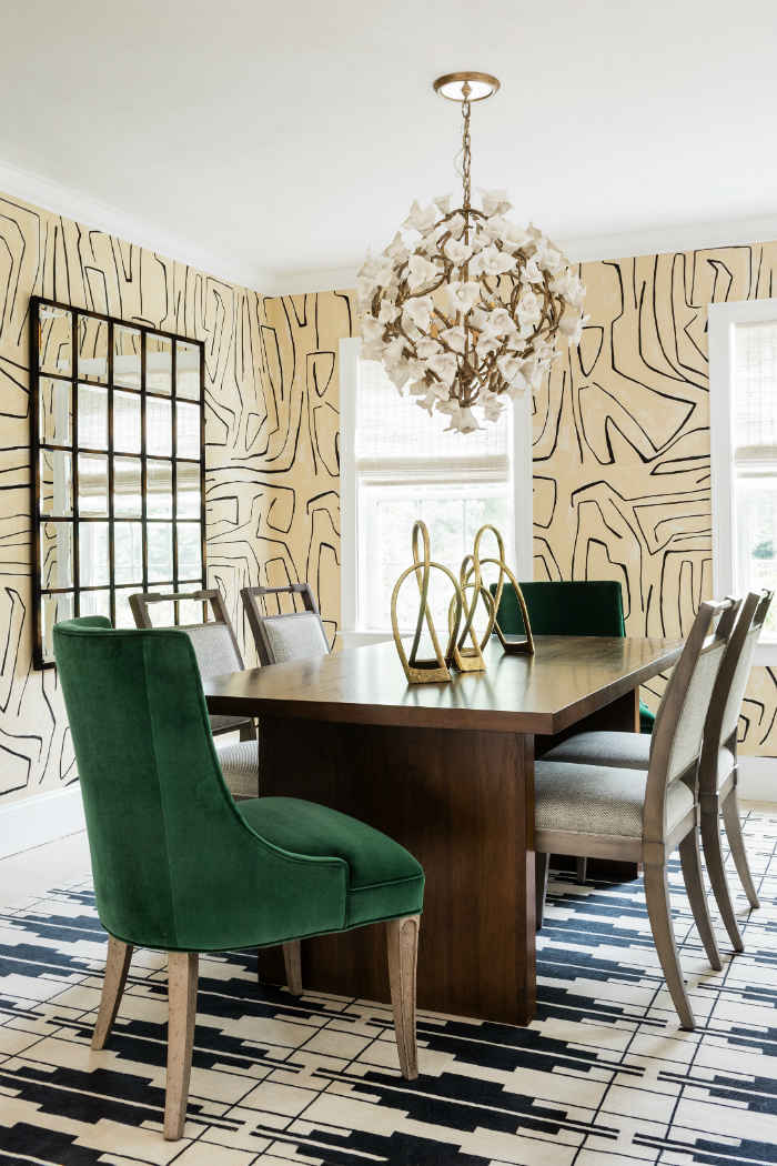 Dining Room With Emerald Chairs And Geometric Area Rug