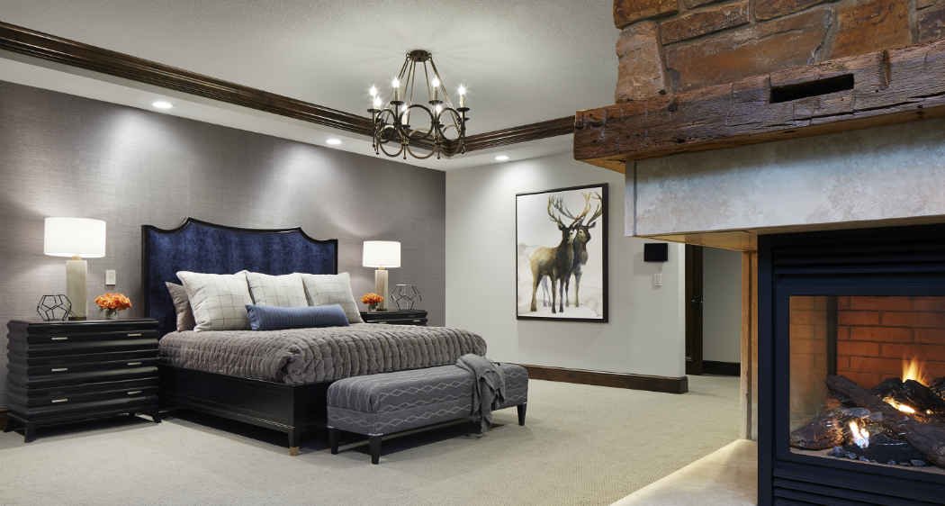 Grand Master Bedroom With Stone Fireplace