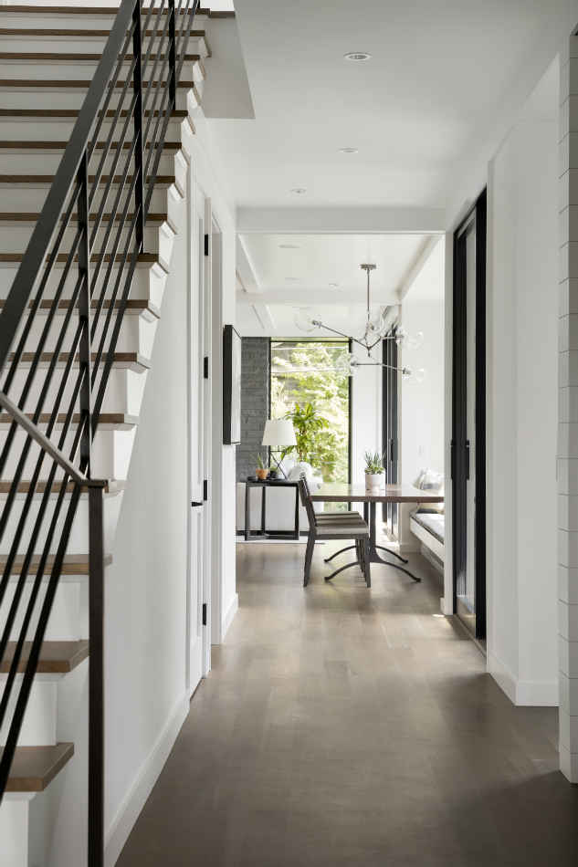 Hallway Interior Design With Metal Rail Staircase