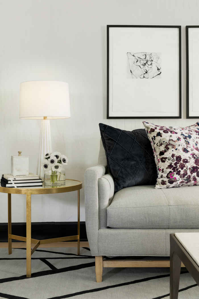 Soft Gray Sofa With Floral Pillows