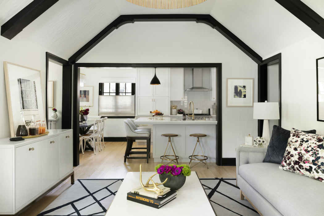 White Living Room With Vaulted Ceilings